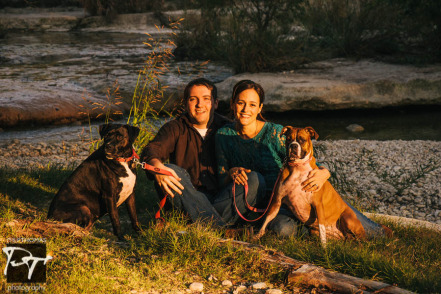 Couple and their dogs at Bull Creek, Austin. Photographed by Philip Thomas