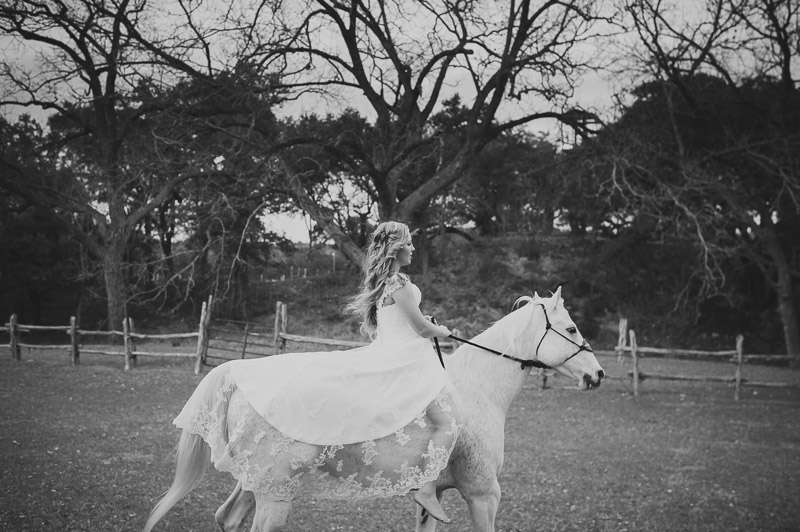 The bride and her horse at Don Strange Ranch