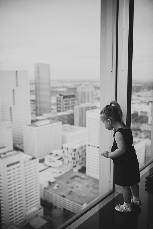 Little girl looks out at Petroleum Club